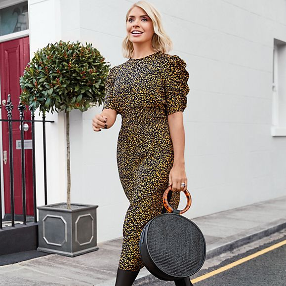 Holly Willoughby wears a leopard-print dress and black basket-weave bag