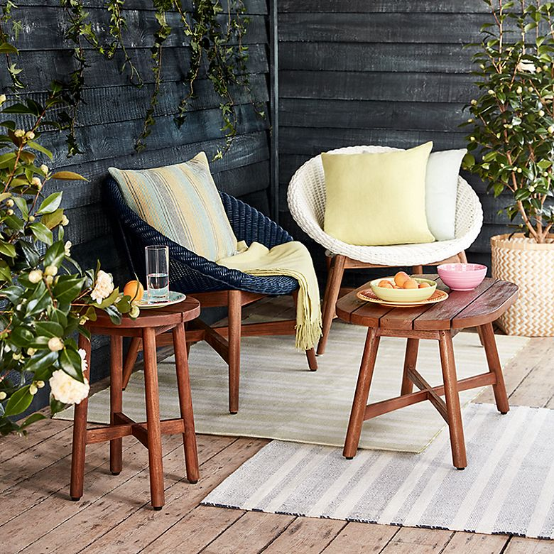 Capri faux wicker and teak garden chairs with cushions and throws