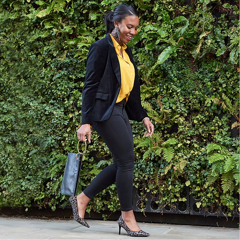 Aleesha wears yellow satin blouse and black jeans from Holly's Must-Haves collection