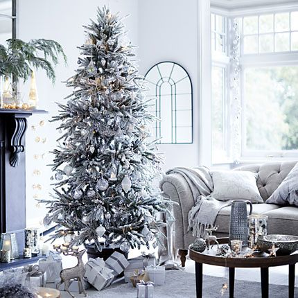 Living room decorated for Christmas in white and silver