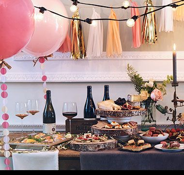 Wedding buffet surrounded by pink balloons and decorations
