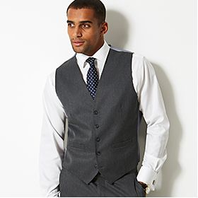 Man wearing grey waistcoat and white shirt