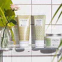 Origins products on a bathroom shelf