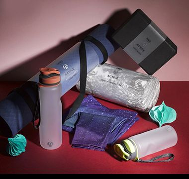 Assortment of gym kit including yoga mat