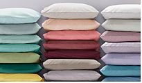 Stacked pillows in different colour pillowcases
