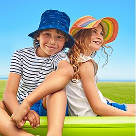 Children wearing M&S summer clothes for holiday