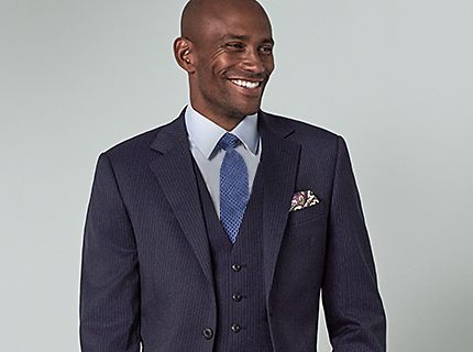 Man wearing pocket square in navy suit