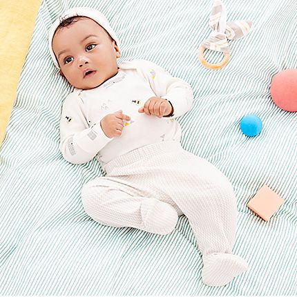Baby on a mat wearing M&S clothing
