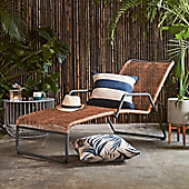Sun lounger in garden with outdoor cushions