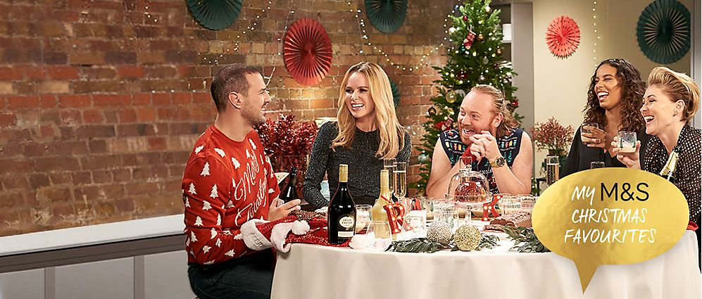 Paddy McGuinness, Amanda Holden, Keith Lemon, Rochelle Humes and Emma Willis in the M&S tasting kitchen surrounded by a Christmas feast