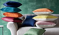 Stacks of cushions in a variety of colours