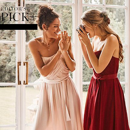 Two women wearing bridesmaid dresses