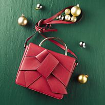 Red handbag with bow detail