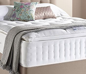 Mattress with blanket and cushions