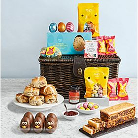 Easter family hamper surrounded by chocolate treats