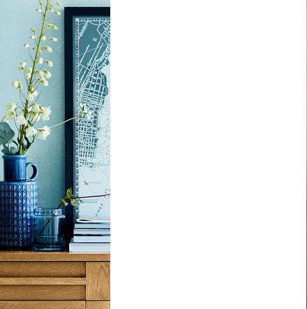 Sonoma wooden sideboard in hallway with vases and wall art