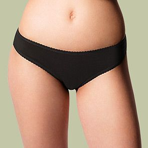 Woman wearing black bikini knickers