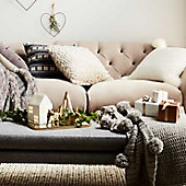 Sofa with cushions and throws in living room
