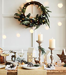 Arrangement of Christmas candles and decorations