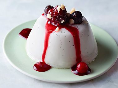 panna cotta topped with frozen fruit and berries