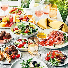 Selection of picnic foods including cold meats and salads
