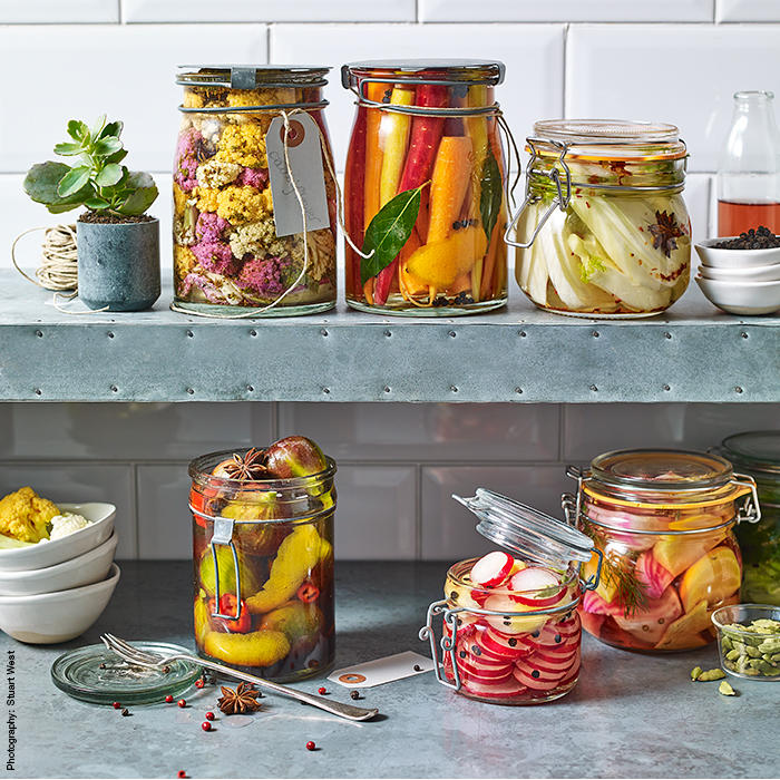 A selection of kilner jars filled with colourful pickled fruits and vegetables