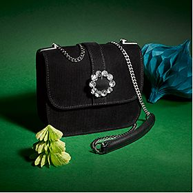 A black jewel-front bag