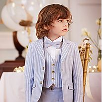 Boy in pale blue suit and bow-tie