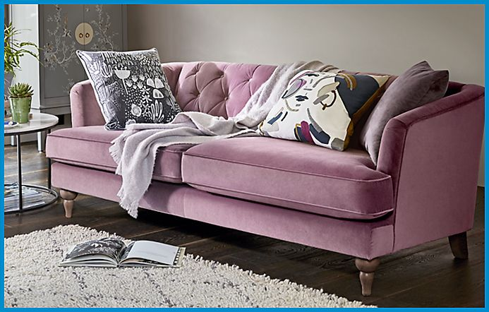 Velvet sofa with cushions