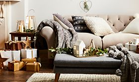 Sofa in living room with Christmas decorations