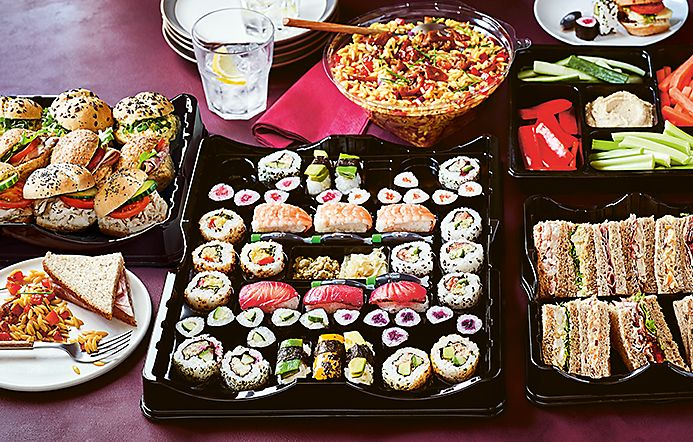 Spread of fresh sushi and sandwiches