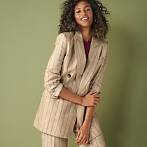 Woman wearing a beige striped linen suit