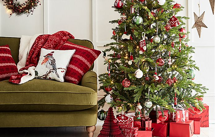 christmas tree surrounded by presents wrapped in red paper