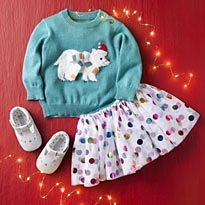 Baby girl outfit on red Christmas background
