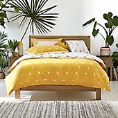 Yellow tiger print bedding on bed