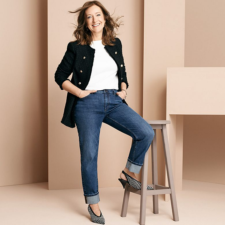 Jill McDonald wears jeans, T-shirt and a statement tweed jacket