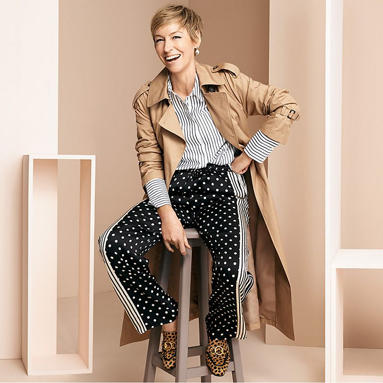 Jo Elvin wears polka dot and striped trousers, a striped shirt and leopard print loafers