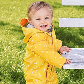 Baby wearing yellow coat