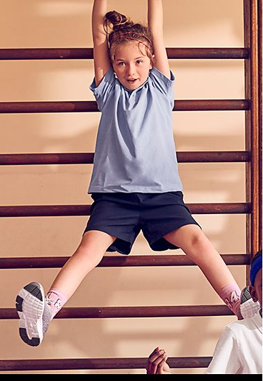Girl wearing M&S school gym kit with a plain T-shirt