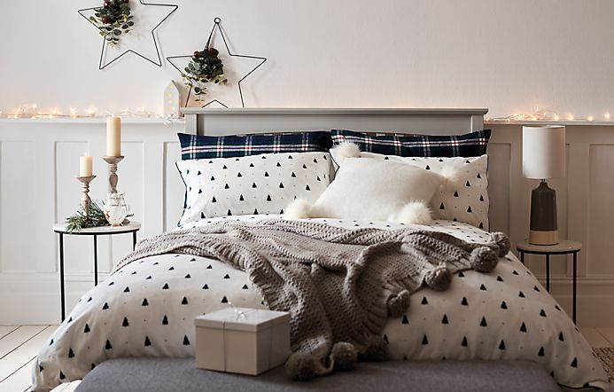 Bedroom with white wooden bedroom furniture and festive bed linen