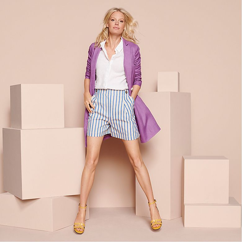 Woman wearing lilac jacket with striped shorts