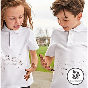 Children wearing M&S school uniform polos showing its stain resistant technology