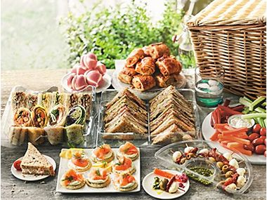 A selection of sandwiches and sweet and savoury snacks