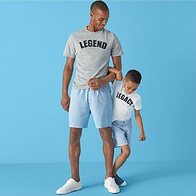 Man and son wearing matching T-shirts and shorts