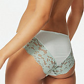 Woman wearing mint green lace-trim knickers