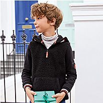 Boy wearing a dark jumper