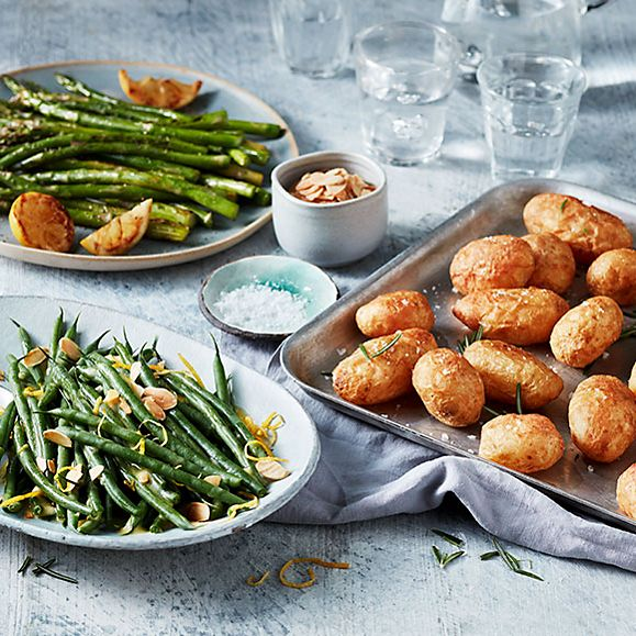 A table of roasted Jersey Royals, extra-fine asparagus and green beans with toasted almonds and lemon zest