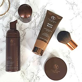 Vita Liberata products on a marble surface