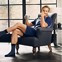 Man sitting in an armchair wearing M&S socks