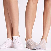 Women wearing patterned trainer socks